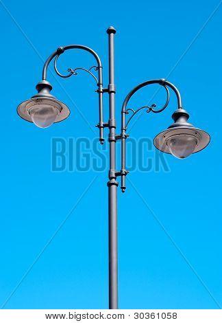Two Street Lamp On Metal Lamppost