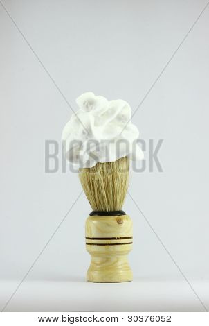 The shaving brush with shaving foam.