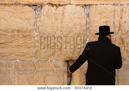 JERUSALEM - FEBRUARY 12: A hassidic Jew prays at the wailing wall in the Old City February 12, 2012 in Jerusalem, Israel. The wall is is one of the most sacred sites in Judaism.