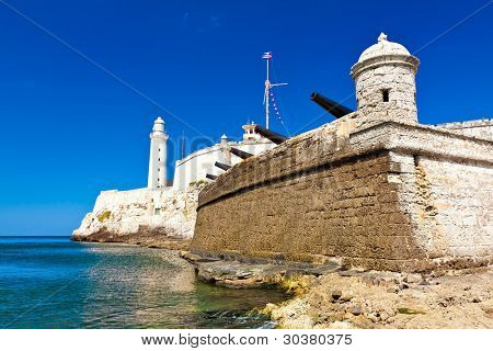 The famous castle and lighthouse of El Morro in the bay of Havana and a battery of old cannons
