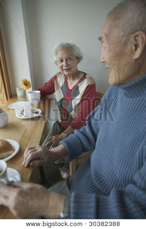 Senior couple sitting at table