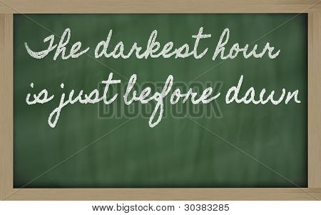Expression -  The Darkest Hour Is Just Before Dawn - Written On A School Blackboard With Chalk
