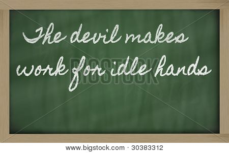 Expression -  The Devil Makes Work For Idle Hands - Written On A School Blackboard With Chalk