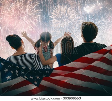 poster of Patriotic holiday. Happy family, parents and daughter child girl with American flag outdoors. USA ce