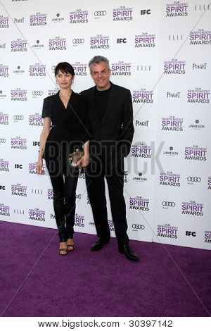 LOS ANGELES - FEB 25:  Olga Kurylenko, Danny Huston arrives at the 2012 Film Independent Spirit Awards at the Beach on February 25, 2012 in Santa Monica, CA