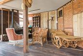 Interior Design Room In Country Loft Style. Interior Design Room Include Rattan Chair And Arm Chair  poster
