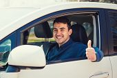 Portrait Of Happy Guy, Uber Driver Showing Thumb Up Positive Gesture, Smiling Gently To Camera. Chee poster