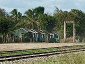 picture of greater antilles  - poor wooden cabins near railroad track at the Dominican Republic a island of Hispanola wich is a part of the Greater Antilles archipelago in the Carribean region - JPG
