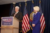 Newt and Calista Gingrich on stage.
