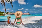 Three year old toddler boy on beach with mother. Summer family vacation at Maldives. poster