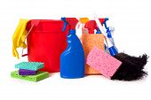 stock photo of cleaning agents  - a variety of cleaning supplies and chemicals on a white background including spray bottles gloves sponges rags and a bucket - JPG
