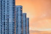 Modern And Luxury Building With Balcony. Apartment Building. Skyscrapers At Dusk. Urban Abstract Bac poster
