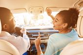 Enjoy Journey. Afro Couple Listening Music, Driving Car poster