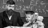 Father With Beard, Teacher Teaches Son, Kid Boy. Teaching Kid Concept. Teacher And Pupil In Mortarbo poster