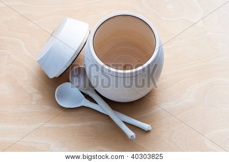 A Barrel Of Honey With Spoons