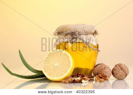Healthy ingredients for strengthening immunity on yellow background