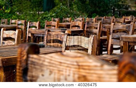 Empty Wooden Chairs And Tables
