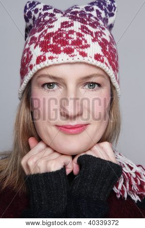 Beautiful happy smiling middle-aged woman in knitted hat and pullover