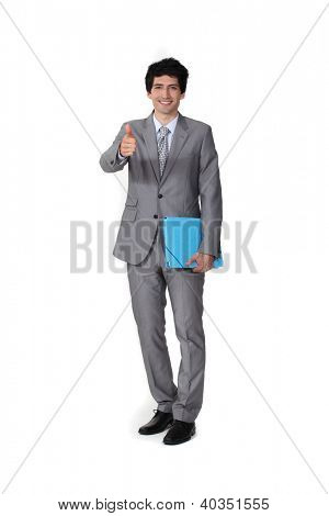 Portrait of a businessman giving the thumb's up