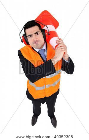 Man with traffic cone