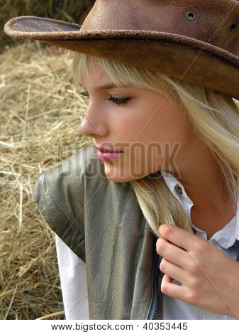 Portrait Of Young Lonely Cowgirl