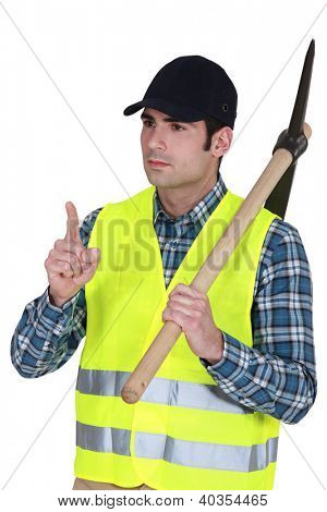 Labourer carrying a pickaxe