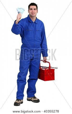 Workman holding up banknotes