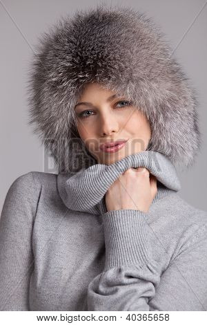 Stylish Woman In Winter Fur Hat