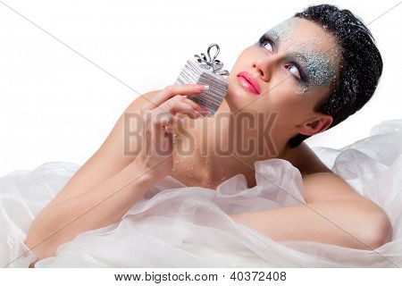 Beautiful woman with frost on face holding present, isolated on white