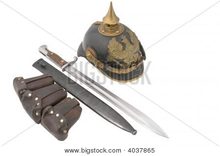 Composition With Old German Helm, Bayonet And Cartridge Pouch