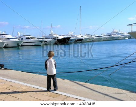 Boy And Luxury Yachts