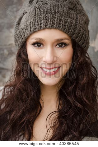 Attractive pretty natural looking young woman with pretty face and smile
