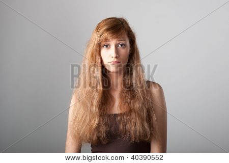 resentful casual girl on gray