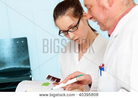 Council of physicians review the results of a genetic test