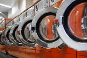 stock photo of laundromat  - Row of retro washing machines in laundromat