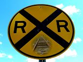 picture of railroad yard  - a railroad sign with pictures of tracks imbedded - JPG