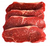 stock photo of porterhouse steak  - Four striploin steaks  - JPG
