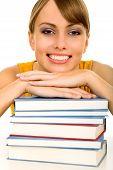 Постер, плакат: Женщина опираясь на стопку книг