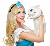 picture of alice wonderland  - Portrait of a young woman dressed as Alice in Wonderland with a rabbit in the hands of - JPG
