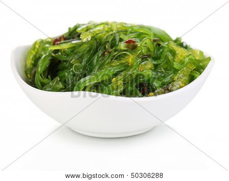 Sea kale in bowl close-up isolated on white