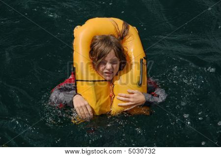 Child In Inflated Lifejacket