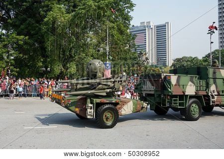 KUALA LUMPUR - AUGUST 31: Cannons from the artillery units take to the city streets in a parade as Malaysians celebrate Independence Day on August 31, 2013 in Kuala Lumpur, Malaysia.