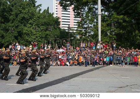 KUALA LUMPUR - AUGUST 31: VAT 69 commandoes from Police force march on the city streets celebrating Malaysia's Independence Day on August 31, 2013 in Kuala Lumpur, Malaysia.