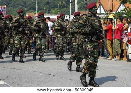 KUALA LUMPUR - AUGUST 31: Paratroopers from the 10th Airborne Brigade march on the city streets as celebrating Malaysia's Independence Day on August 31, 2013 in Kuala Lumpur, Malaysia.