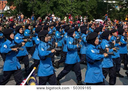 KUALA LUMPUR - AUGUST 31: Women from the paramilitary forces march on the city streets celebrating Malaysia's Independence Day on August 31, 2013 in Kuala Lumpur, Malaysia.