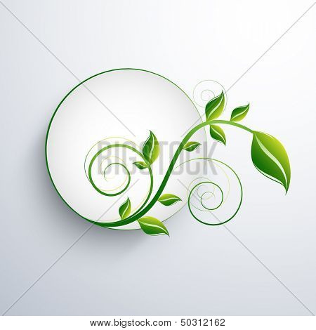 Nature concept with green leafs and space for your text on abstract grey background.