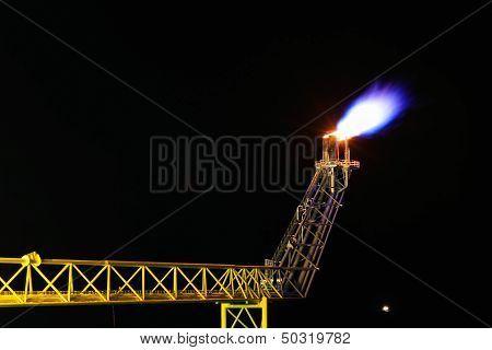 Oil and gas burning at flare platform.