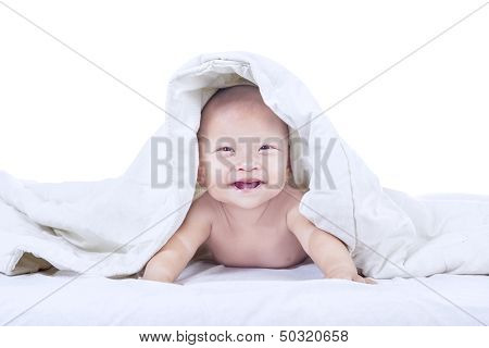 Baby Laughing Inside Blanket - Isolated