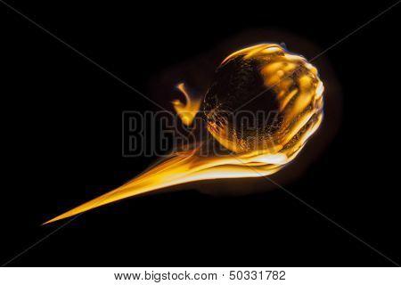 Flaming fireball fastball baseball burning into darkness.