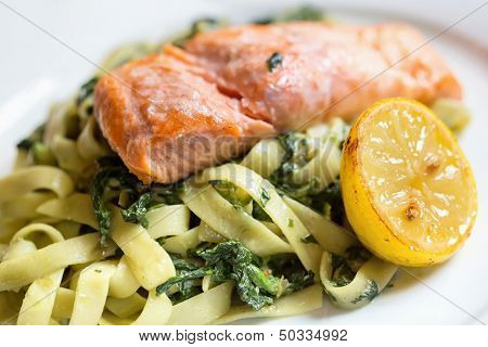 Grilled atlantic salmon fillet, with a fresh pasta salad.